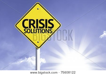 Crisis Solutions road sign with sun background