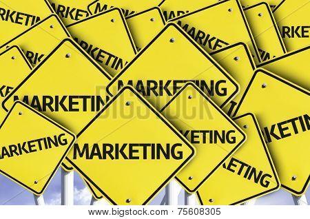 Marketing written on multiple road sign