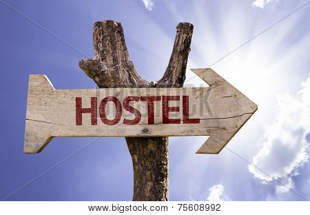 Hostel wooden sign on a beautiful day
