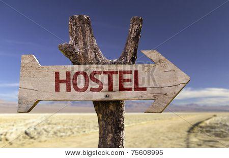 Hostel wooden sign isolated on desert background