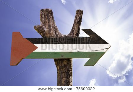 Palestine wooden sign on a beautiful day