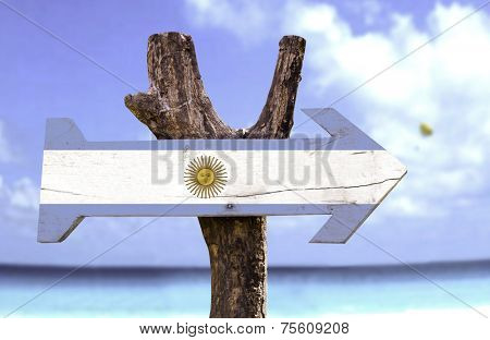 Argentina wooden sign with a beach on background