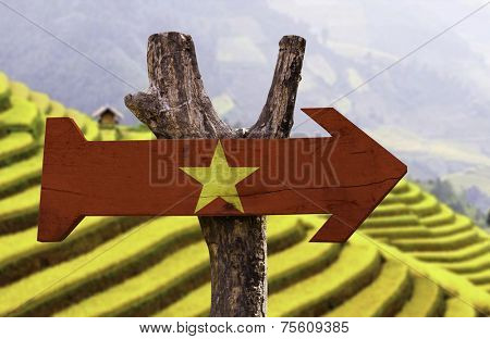 Vietnam wooden sign with a desert background