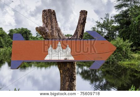 Cambodia wooden sign with a forest on background