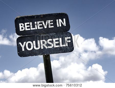 Believe in Yourself sign with clouds and sky