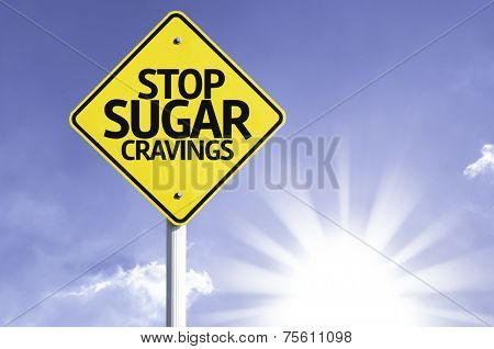 Stop Sugar Cravings road sign with sun background
