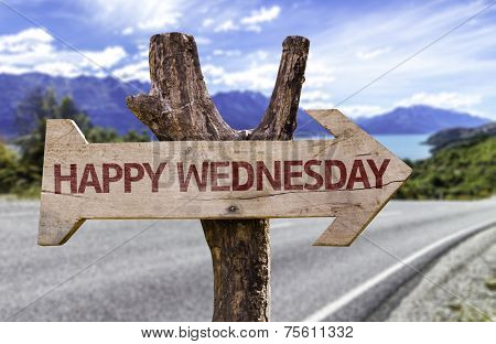 Happy Wednesday wooden sign with a street background