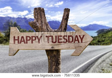 Happy Tuesday wooden sign with a street background