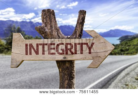 Integrity wooden sign with a street background
