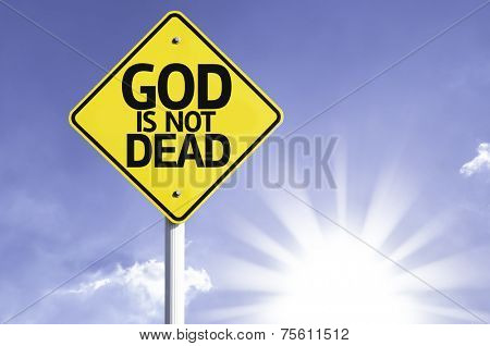 God is not Dead road sign with sun background