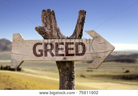 Greed wooden sign with a desert background