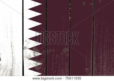 Qatar flag on wooden background