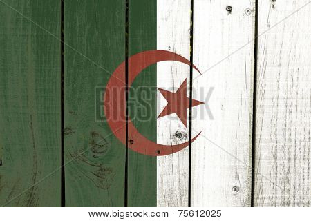 Algeria flag on wooden background