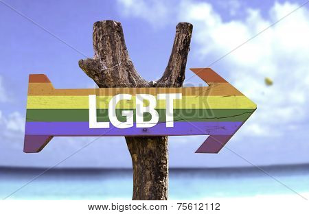 LGBT in a Rainbow wooden sign with a beach on background