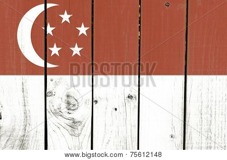 Singapore flag on wooden background