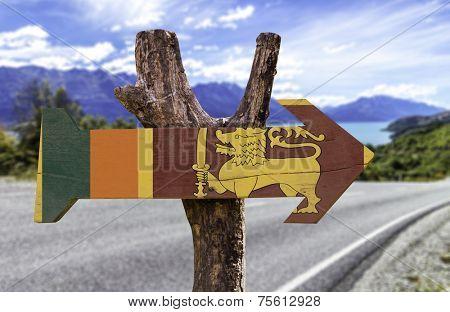 Sri Lanka wooden sign with a landscape background