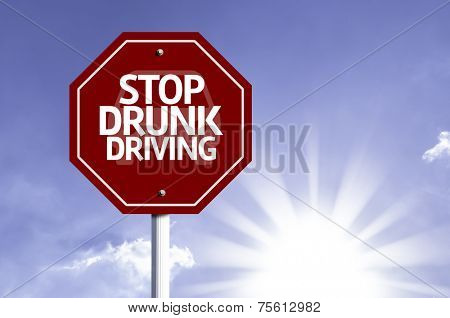 Stop Drunk Driving red sign with sun background