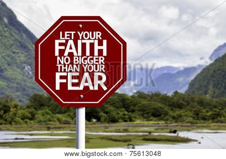 Let your Faith no bigger than your Fear red sign with a landscape background
