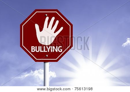 Stop Bullying red sign with sun background