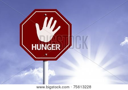Stop Hunger red sign with sun background