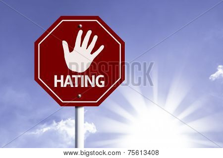 Stop Hating red sign with sun background