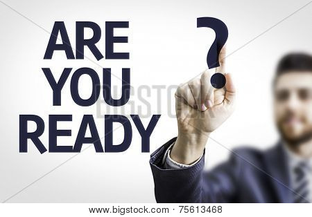 Business man pointing to transparent board with text: Are you Read?