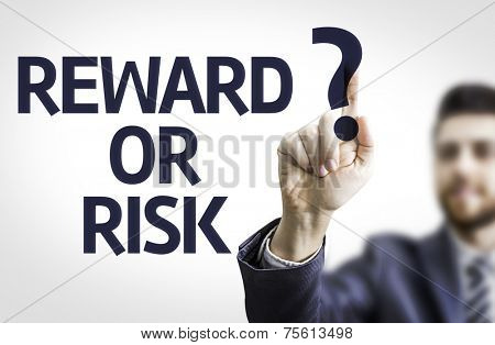Business man pointing to transparent board with text: Reward or Risk?