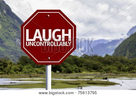 Laugh Uncontrollably red sign with a landscape background