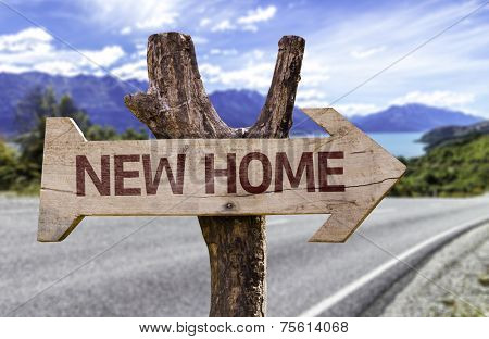 New Home wooden sign with a street background