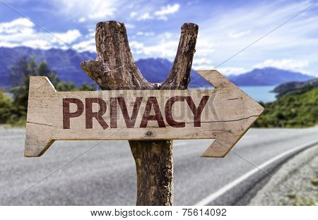 Privacy sign with a road background