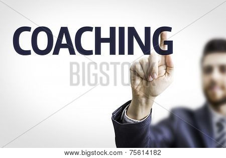 Business man pointing to transparent board with text: Coaching