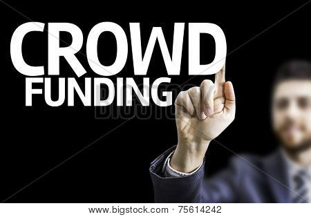 Business man pointing to black board with text: Crowd Funding