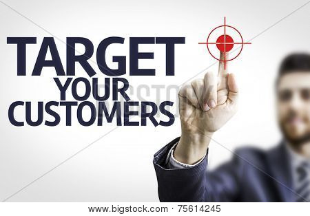 Business man pointing to transparent board with text: Target Your Customers