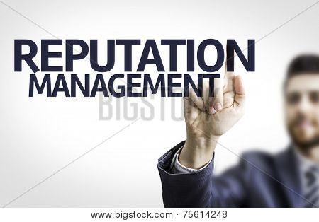 Business man pointing to transparent board with text: Reputation Management