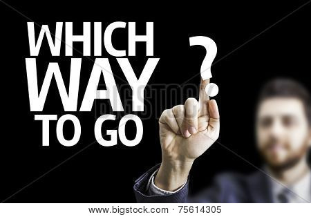 Business man pointing to black board with text: Which Way to Go?