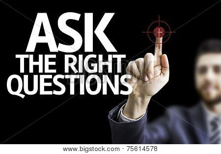 Business man pointing to black board with text: Ask The Right Questions
