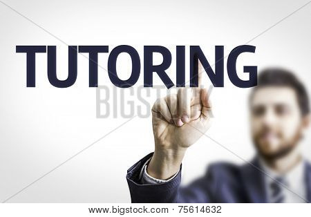 Business man pointing to transparent board with text: Tutoring