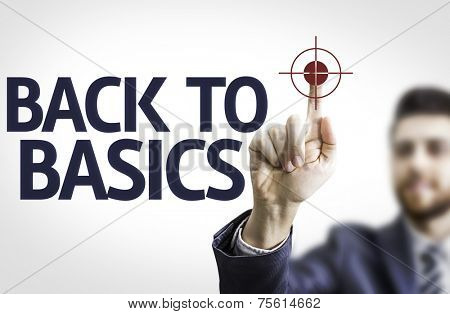 Business man pointing to transparent board with text: Back to Basics