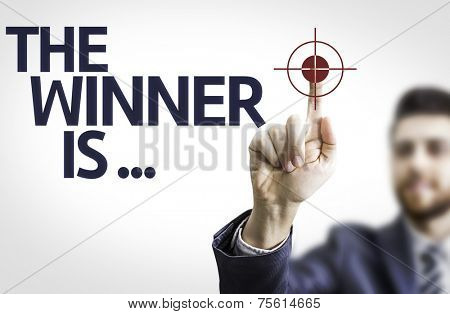 Business man pointing to transparent board with text: The Winner Is...