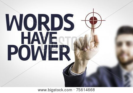 Business man pointing to transparent board with text: Words Have Power