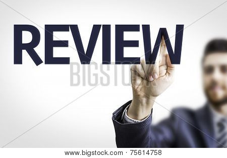 Business man pointing to transparent board with text: Review
