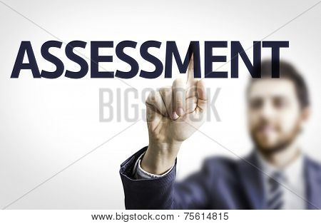 Business man pointing to transparent board with text: Assessment