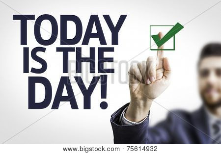Business man pointing to transparent board with text: Today is The Day!