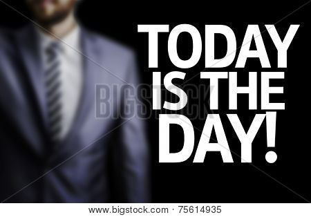 Today is The Day! written on a board with a business man on background