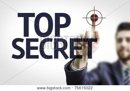 Business man pointing to transparent board with text: Top Secret