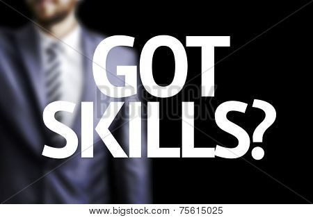 Got Skills? written on a board with a business man on background