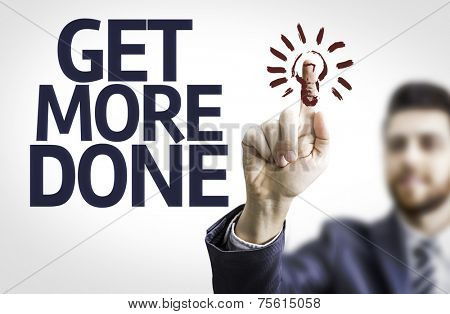 Business man pointing to transparent board with text: Get More Done
