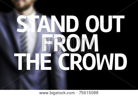 Stand Out From the Crowd written on a board with a business man on background