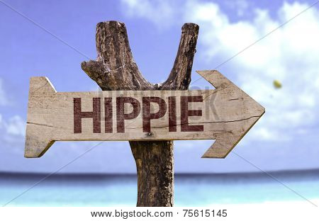 Hippie wooden sign with a beach on background