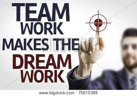 Business man pointing to transparent board with text: Team Work Makes the Dream Work